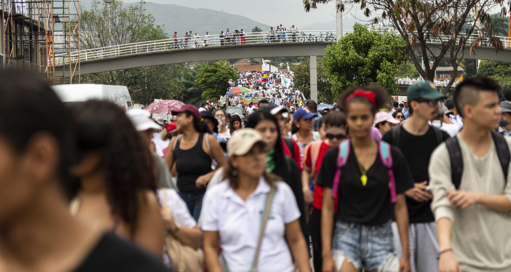 Colombiaanse activisten slaan handen in elkaar voor grondrechten en vrede